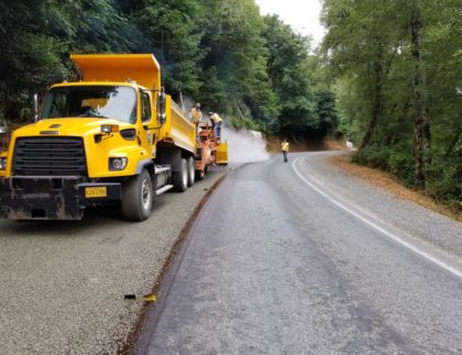 Albina Asphalt chip and fog sealing Curry County's River road.